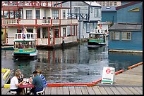 Harbor ferries and outdoor eatery, Upper Harbor. Victoria, British Columbia, Canada