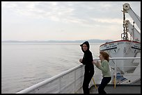 Woman and girl looking out from deck of ferry. Vancouver Island, British Columbia, Canada (color)