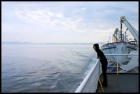 Woman looking out from deck of ferry. Vancouver Island, British Columbia, Canada ( color)