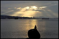 Girl in wetsuit statue, sunrise, Stanley Park. Vancouver, British Columbia, Canada (color)