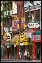Street in Chinatown with red lamp posts and Chinese script. Vancouver, British Columbia, Canada (color)