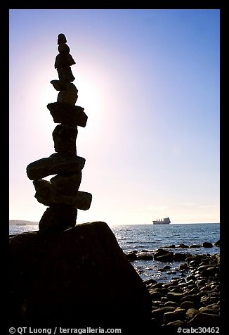 Backlit balanced rocks and ship in the distance. Vancouver, British Columbia, Canada (color)