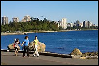 Family walking around Stanley Park. Vancouver, British Columbia, Canada