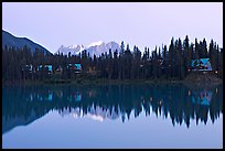 Trees and cabins reflected in Emerald Lake, dusk. Yoho National Park, Canadian Rockies, British Columbia, Canada ( color)