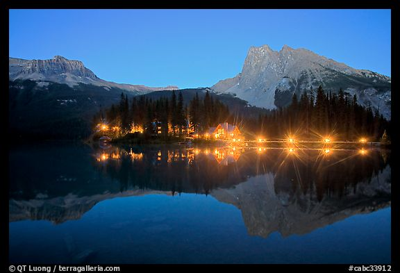 Lighted cabins and mountains reflected in Emerald Lake at night. Yoho National Park, Canadian Rockies, British Columbia, Canada (color)