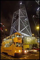 Old tram and Bank of China building (369m), designed by Pei, by night. Hong-Kong, China ( color)