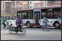 Tricyle, bicycles and bus on street. Beijing, China