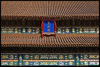 Roof detail and sign on Hall of Supreme Harmony, Forbidden City. Beijing, China