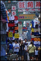 Crowded alley with clothing vendors, Kowloon. Hong-Kong, China ( color)