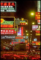 Nathan road, brilliantly lit by neon lights at night, Kowloon. Hong-Kong, China ( color)