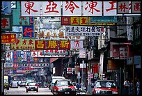 Taxicabs in a street filled up with signs in Chinese, Kowloon. Hong-Kong, China ( color)
