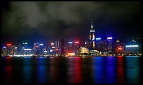 Colorful reflections of Hong-Kong Island lights across the harbor by night. Hong-Kong, China ( color)
