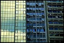 Glass building next to older buildings with air conditioners, Hong-Kong Island. Hong-Kong, China ( color)