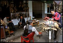 Loading roasted meat on a bicycle. Kunming, Yunnan, China ( color)