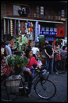 Flower peddler in an old alley. Kunming, Yunnan, China ( color)