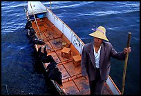 Cormorant Fisherman in a boat with his fishing birds. Dali, Yunnan, China (color)
