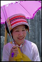 Woman from the Sani branch of the Yi tribespeople with a sun unbrella. Shilin, Yunnan, China ( color)