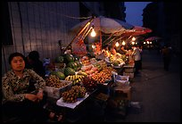 Fruit vendor, night market. Leshan, Sichuan, China