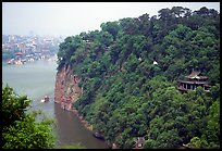 Cliffs of Lingyun Hill with the city in the background. Leshan, Sichuan, China ( color)