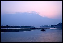Boat at the confluence of the Dadu He and Min He rivers at sunset. Leshan, Sichuan, China ( color)
