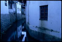 White walled houses surrounding a canal. Lijiang, Yunnan, China ( color)