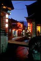 Streets, bridge, wooden houses, red lanterns and canal. Lijiang, Yunnan, China ( color)