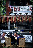 Women eat outside the Snack Food in Lijiang restaurant. Lijiang, Yunnan, China ( color)