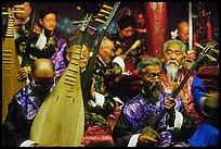 Elderly musicians of the Naxi Orchestra playing traditional instruments. Lijiang, Yunnan, China (color)