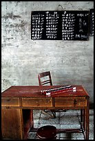 Desk counting frame and Chinese script on blackboard. Emei Shan, Sichuan, China ( color)