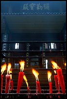Candles burning in front of Wannian Si temple. Emei Shan, Sichuan, China