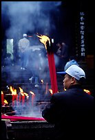 Pilgrim offering big incense stick. Emei Shan, Sichuan, China ( color)