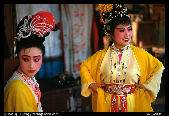 Two characters of Sichua opera off stage. Chengdu, Sichuan, China (color)