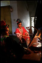 Sichuan opera actors getting ready in the backstage before the performance. Chengdu, Sichuan, China (color)