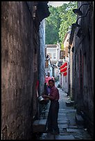 Man using stream water in alley. Hongcun Village, Anhui, China ( color)