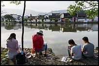 Art students painting along South Lake. Hongcun Village, Anhui, China ( color)