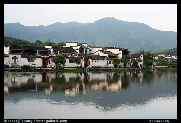 Hongcun village and mountains reflected in South Lake. Hongcun Village, Anhui, China (color)