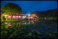 Houses reflected in South Lake at night. Hongcun Village, Anhui, China ( color)