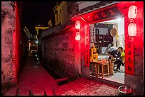 Shopkeeper and alley at night. Hongcun Village, Anhui, China ( color)