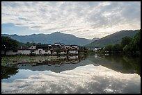 Village and clouds reflected in South Lake. Hongcun Village, Anhui, China ( color)