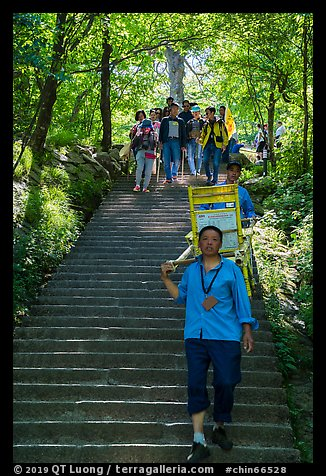 Sedan chair carriers on steep staircase. Huangshan Mountain, China (color)