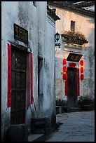 Morning light streaming on walls with lanterns. Xidi Village, Anhui, China ( color)