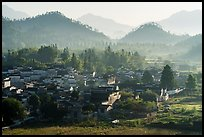Village and hills in morning fog. Xidi Village, Anhui, China ( color)