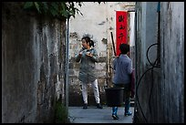 Two women in alley. Xidi Village, Anhui, China ( color)
