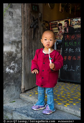 Boy with toothbrush. Xidi Village, Anhui, China (color)