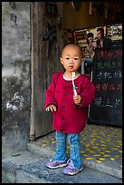 Boy with toothbrush. Xidi Village, Anhui, China ( color)