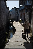 Woman carrying buckets. Xidi Village, Anhui, China ( color)