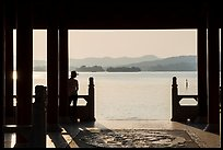 Man in Cuiguang Pavilion and West Lake. Hangzhou, China