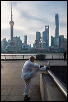 Man stretching and Oriental Pearl Tower, the Bund. Shanghai, China ( color)