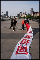 Men folding kite, the Bund. Shanghai, China ( color)