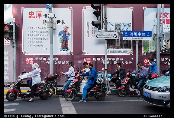 Motercycle riders waiting at trafic light. Shanghai, China (color)